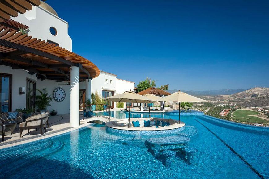The property features a 2,000 square foot infinity pool, with a sunken round lounge area. The house overlooks the Baja ocean...it's blue as far as the eye can see!