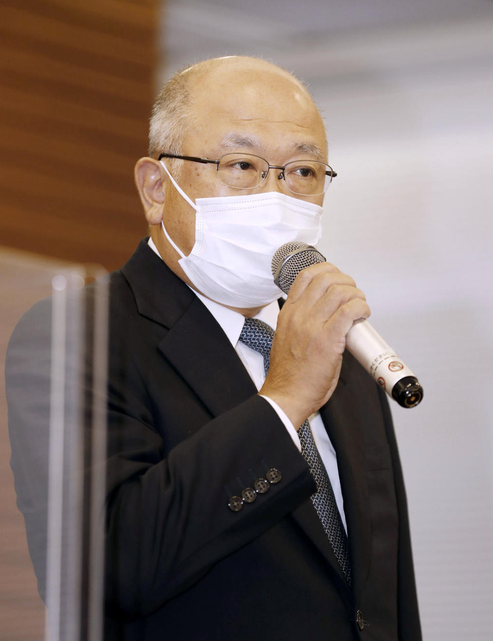 Mitsui O.S.K.Lines Representative Director Akihiko Ono speaks during a press conference in Tokyo, Sunday, Aug. 9, 2020. The owners and operators of the grounded ship Wakashio on Sunday apologized for the accident that has led to tons of fuel leaking into Mauritius waters. (Kyodo News via AP)