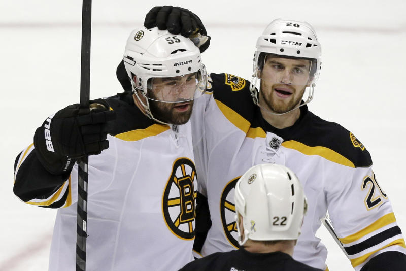 Boston Bruins' Johnny Boychuk (55) celebrates his goal with teammate Daniel Paille (20) in the third period of Game 2 of the NHL hockey playoffs Stanley Cup Eastern Conference finals against the Pittsburgh Penguins, in Pittsburgh on Monday, June 3, 2013. The Bruins won 6-1. (AP Photo/Gene J. Puskar)