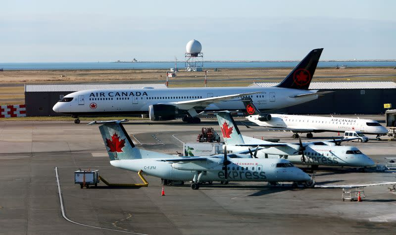 FILE PHOTO: FILE PHOTO: Air Canada airplanes are pictured at Vancouver's international airport in Richmond,