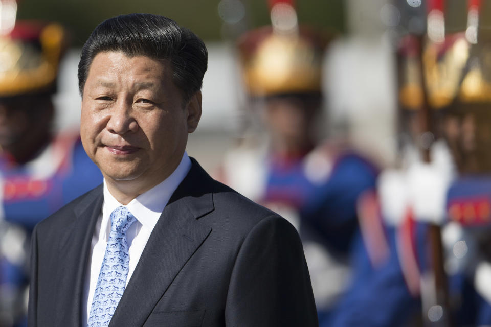 China's President Xi Jinping walks past an honor guard as he arrives for a meeting with Brazil's President Dilma Rousseff at the Planalto Presidential Palace, in Brasilia, Brazil, Thursday, July 17, 2014. (AP Photo/Felipe Dana)