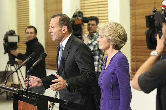 CANBERRA, AUSTRALIA - JUNE 26: Opposition leader Tony Abbott (L) and Julie Bishop speak to the media at Parliament House on June 26, 2013 in Canberra, Australia. In a snap leadership ballot held tonight Kevin Rudd was re-elected to leader of the ALP, a role he held from 2006 to 2010, before he was dumped by the party. Julia Gillard announced before the ballot that she would leave politics if she lost the ballot. (Photo by Stefan Postles/Getty Images)