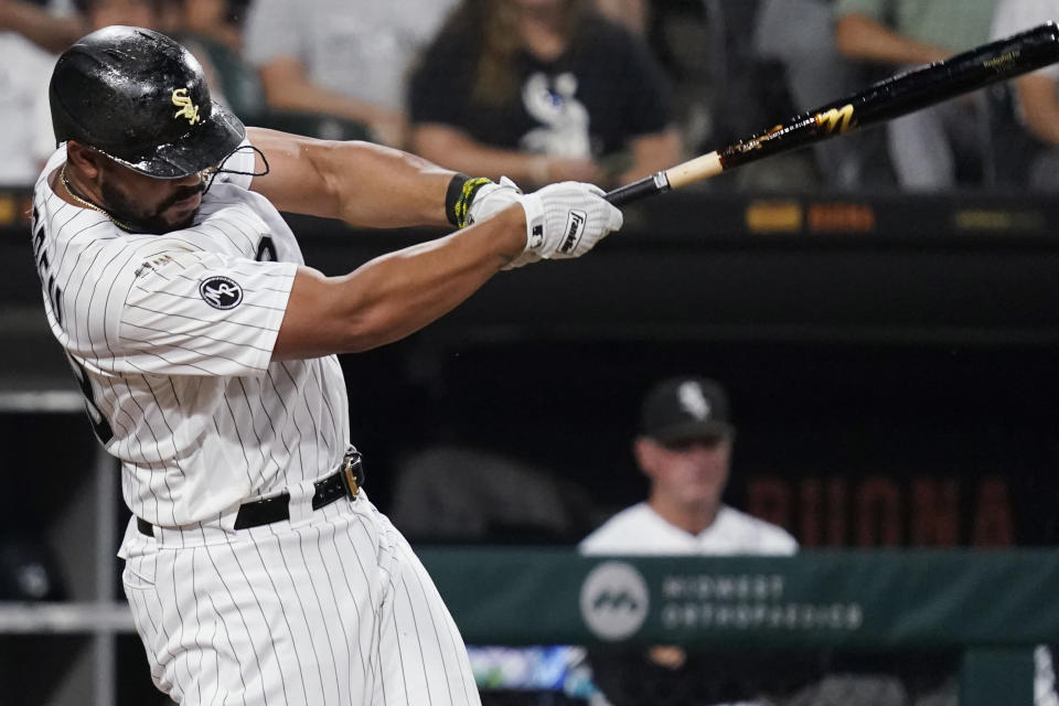 Chicago White Sox's Jose Abreu hits an RBI single during the first inning of the team's baseball game against the Chicago Cubs in Chicago, Friday, Aug. 27, 2021. (AP Photo/Nam Y. Huh)