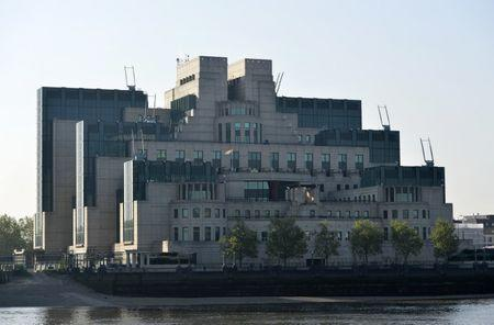 The MI6 Vauxhall Cross building raises the Rainbow Flag to mark its support for the International Day Against Homophobia, Transphobia and Biphobia in London