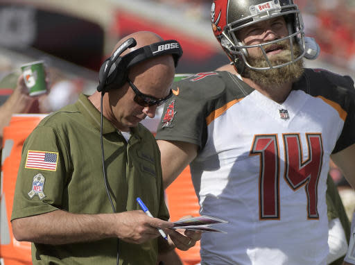 FILE - In this Nov. 11, 2018 file photo, then-Tampa Bay Buccaneers quarterbacks coach Mike Bajakian, left, works with quarterback Ryan Fitzpatrick on the sideline during the first half of an NFL football game against the Washington Redskins in Tampa, Fla. Bajakian was named Boston College offensive coordinator on Jan. 14. 2019.(AP Photo/Phelan M. Ebenhack, File)