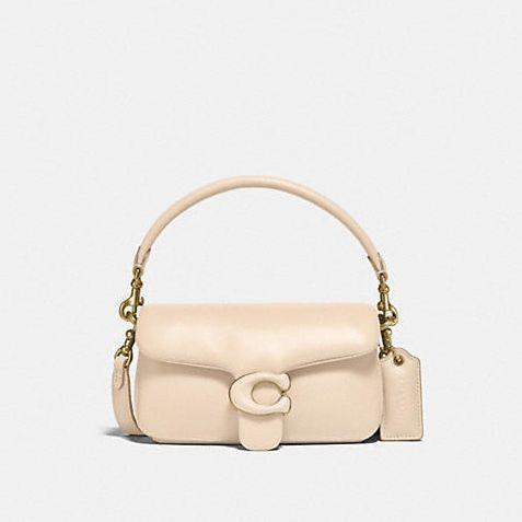 """<p><strong>$395.00</strong></p><p><a href=""""https://go.redirectingat.com?id=74968X1596630&url=https%3A%2F%2Fwww.coach.com%2Fproducts%2Fpillow-tabby-shoulder-bag-18%2FC3880.html&sref=https%3A%2F%2Fwww.cosmopolitan.com%2Fstyle-beauty%2Ffashion%2Fg8274845%2Fbest-gifts-teenage-girls%2F"""" rel=""""nofollow noopener"""" target=""""_blank"""" data-ylk=""""slk:Shop Now"""" class=""""link rapid-noclick-resp"""">Shop Now</a></p>"""