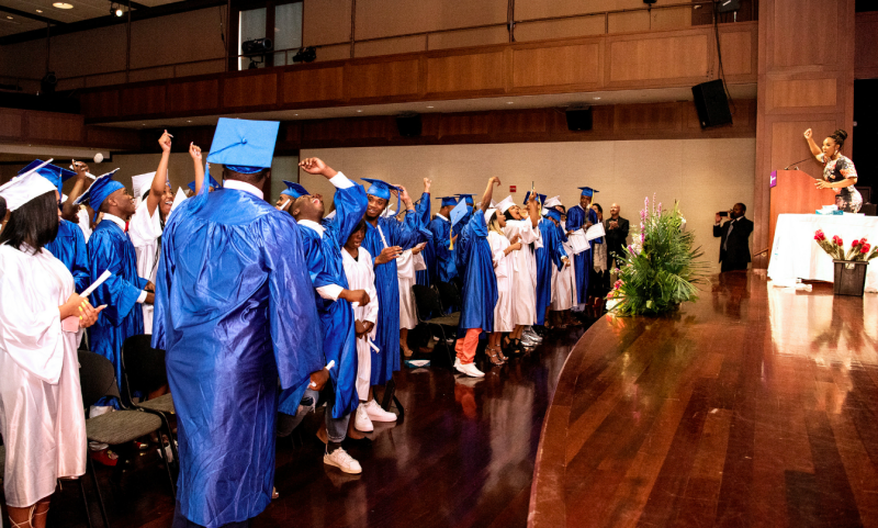 AIM I students at their graduation last year. (Photo Credit: Julienne Schaer)