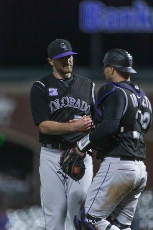 May 17, 2018; San Francisco, CA, USA; Colorado Rockies catcher Chris Iannetta (22) congratulates relief pitcher Wade Davis (71) at end of game against the San Francisco Giants at AT&T Park. Mandatory Credit: Neville E. Guard-USA TODAY Sports
