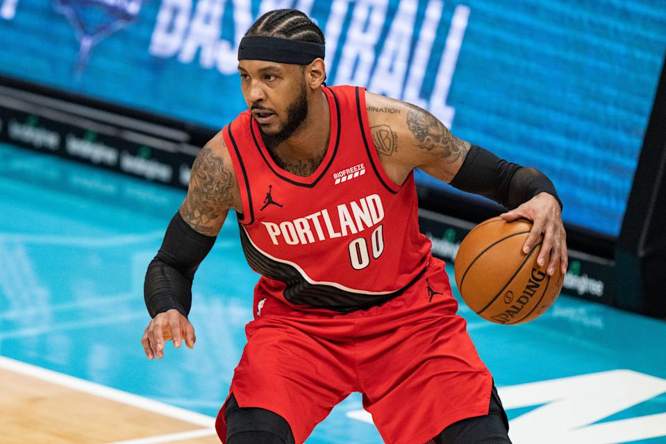 Carmelo Anthony #00 of the Portland Trail Blazers brings the ball up court against the Charlotte Hornets at Spectrum Center on April 18, 2021 in Charlotte, North Carolina. NOTE TO USER: User expressly acknowledges and agrees that, by downloading and or using this photograph, User is consenting to the terms and conditions of the Getty Images License Agreement. (Photo by Jacob Kupferman/Getty Images)