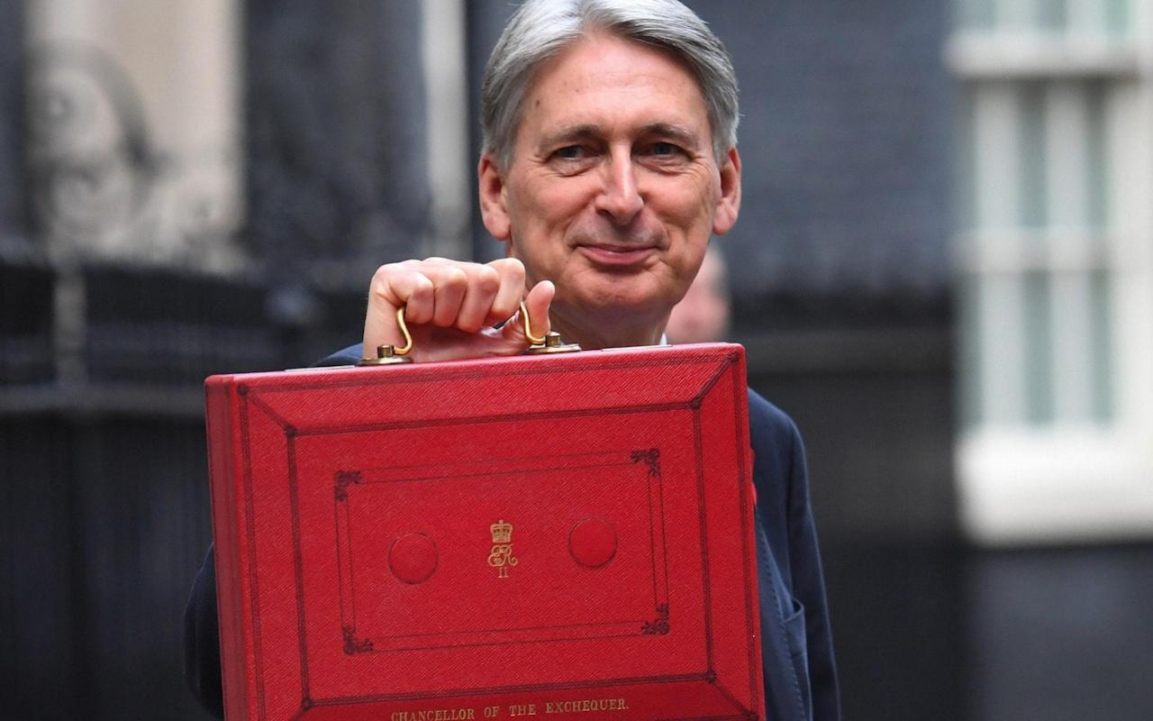 There could be £30bn less in that briefcase at the time of the next Budget if the UK leaves the EU without a deal, the OBR said - PA