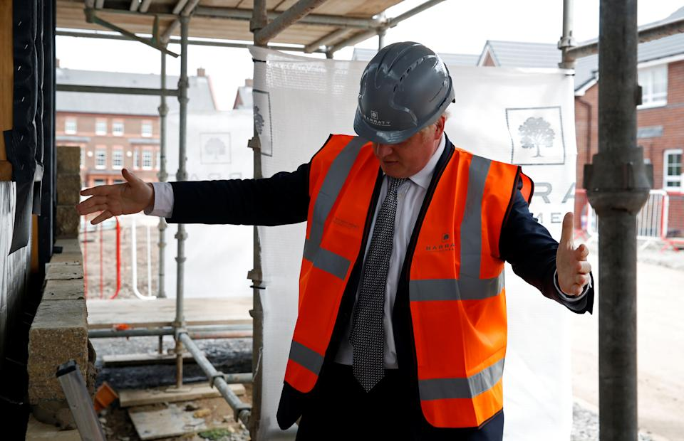 WARRINGTON, UNITED KINGDOM - AUGUST 6: Prime Minister Boris Johnson visits a construction site, on August 6, 2020 in Warrington, United Kingdom. The Prime Minister is announcing what are described as 'once in a generation' planning reforms in a bid to accelerate the construction of new homes. (Photo by Phil Noble - WPA Pool/Getty Images)