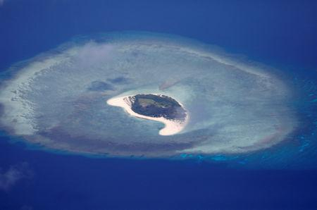 FILE PHOTO: An aerial view of uninhabited island of Spratlys in the disputed South China Sea