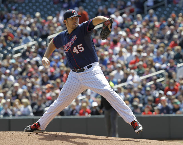 Minnesota Twins pitcher Phil Hughes delivers to the Baltimore Orioles during the first inning of a baseball game in Minneapolis, Sunday, May 4, 2014. (AP Photo/Ann Heisenfelt)