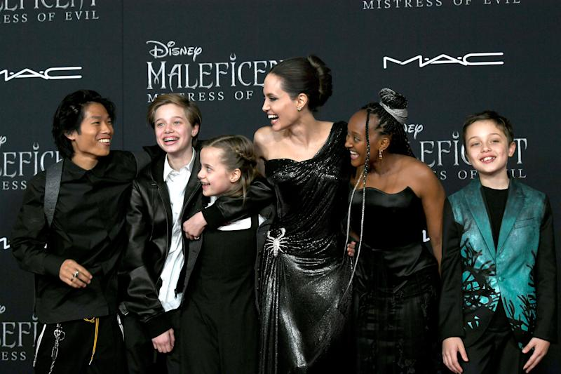 "LOS ANGELES, CALIFORNIA - SEPTEMBER 30: (L-R) Pax Thien Jolie-Pitt, Shiloh Nouvel Jolie-Pitt, Vivienne Marcheline Jolie-Pitt, Angelina Jolie, Zahara Narley Jolie-Pitt and Knox Leon Jolie-Pitt arrive at the premiere of Disney's ""Maleficent: Mistress Of Evil"" at the El Capitan Theatre on September 30, 2019 in Los Angeles, California. (Photo by Kevin Winter/Getty Images)"