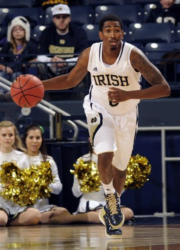 Notre Dame guard Eric Atkins heads up court in the first half of an NCAA college basketball game with Brown on Saturday Dec. 8, 2012 in South Bend, Ind. (AP Photo/Joe Raymond)