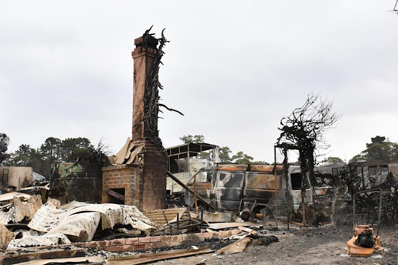 Burnt out and abandoned communities have been targeted by alleged thieves. Pictured is a destroyed home in the Southern Highlands town of Wingello. Source: AAP