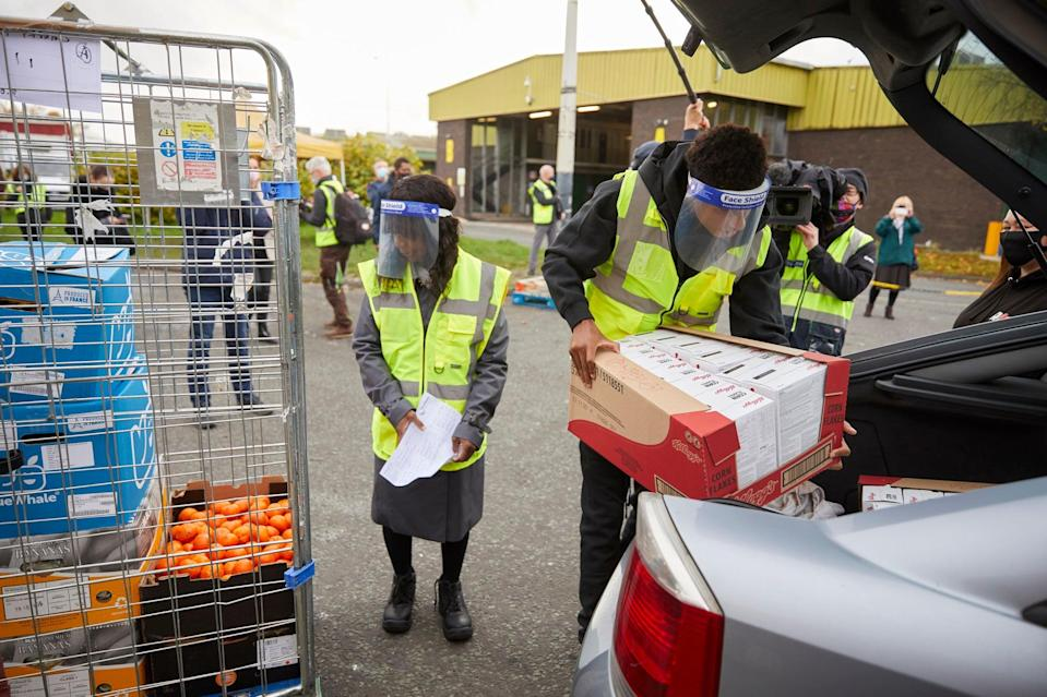 England football star Marcus Rashford visiting FareShare Greater Manchester at New Smithfield Market with his mother (left) (Fareshare/Mark Waugh/PA Wire)