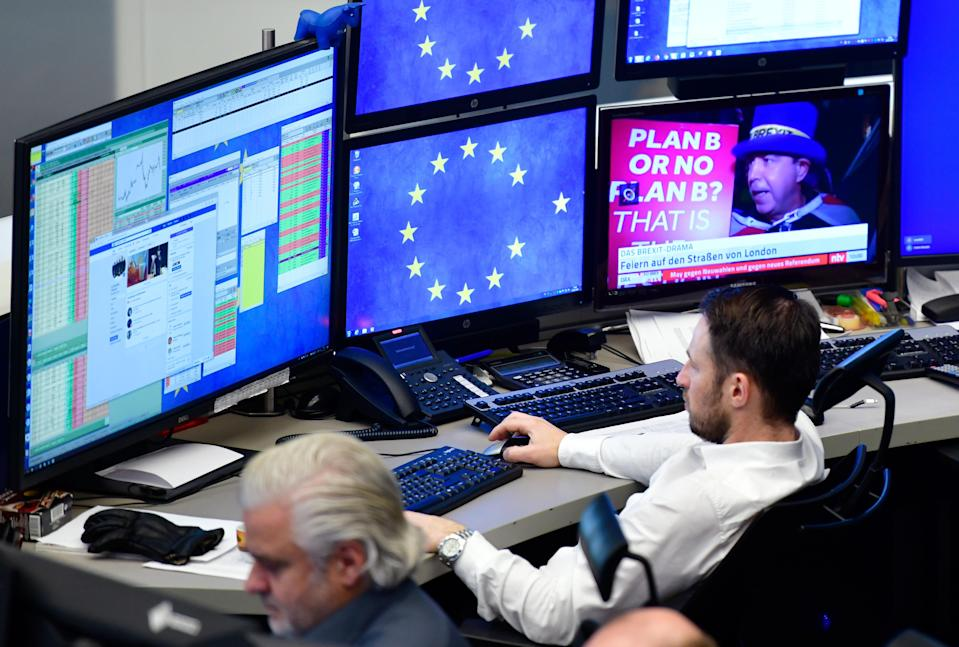 A trader looks at his computer screens at the Frankfurt Stock Exchange. Photo: Thomas Lohnes/Getty ImagesID