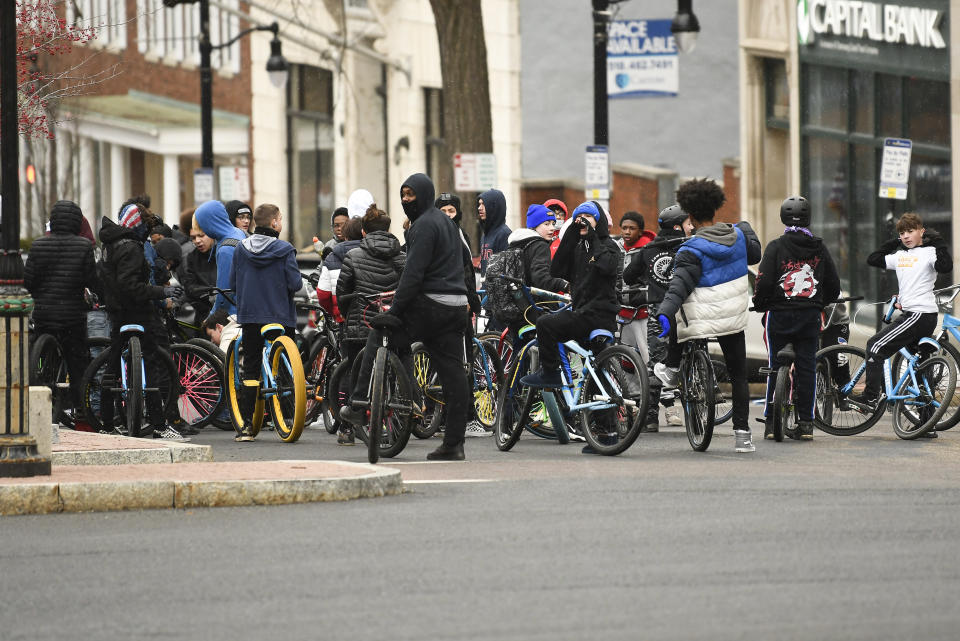 A bicycle meetup group of teenagers protest President Donald Trump ahead of the inauguration of President-elect Joe Biden and Vice President-elect Kamala Harris at the New York State Capitol Sunday, Jan. 17, 2021, in Albany, N.Y. (AP Photo/Hans Pennink)
