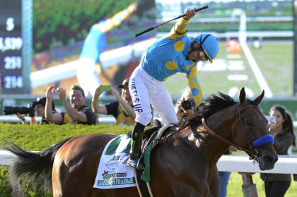 Victor Espinoza reacts after crossing the finish line with American Pharoah to win the Triple Crown. (AP)