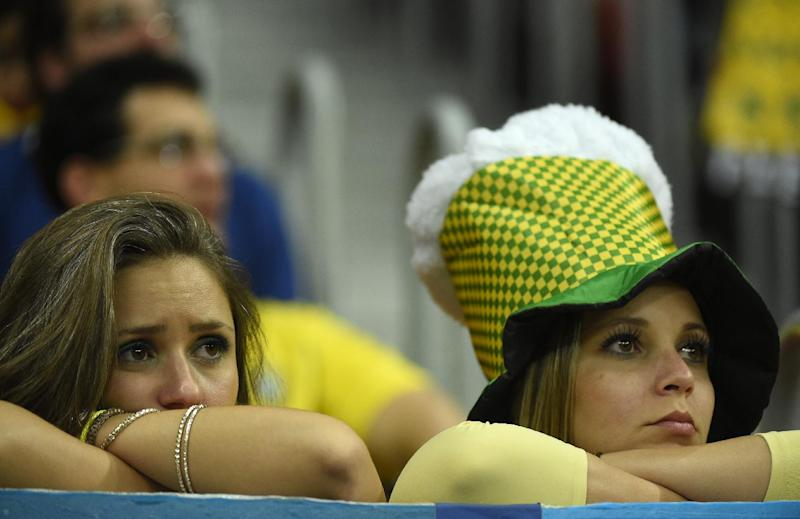 Brazil's fans react after the third place play-off football match between Brazil and Netherlands at the National Stadium in Brasilia on July 12, 2014 (AFP Photo/Odd Andersen)