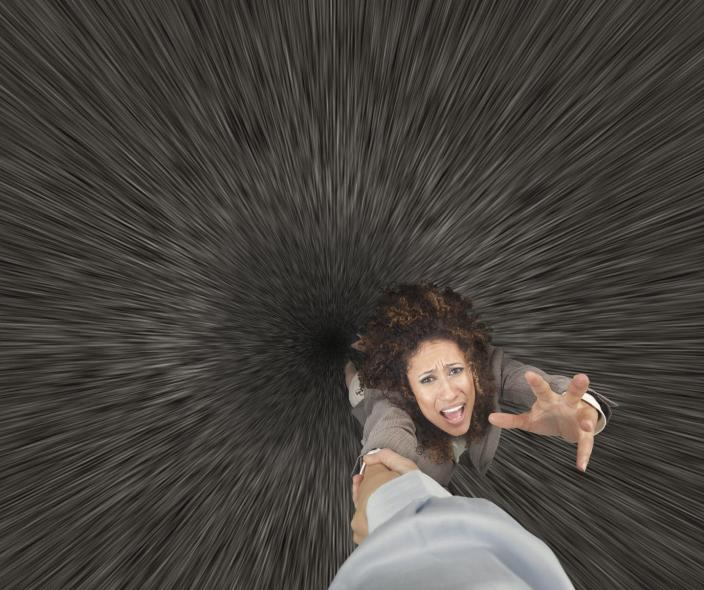 "<span class=""caption"">Falling into a black hole is easily the worst way to die.</span> <span class=""attribution""><a class=""link rapid-noclick-resp"" href=""https://www.gettyimages.com/detail/photo/mixed-race-businesswoman-clinging-to-colleagues-royalty-free-image/476804893?adppopup=true"" rel=""nofollow noopener"" target=""_blank"" data-ylk=""slk:John M Lund Photography Inc/Getty Images"">John M Lund Photography Inc/Getty Images</a></span>"