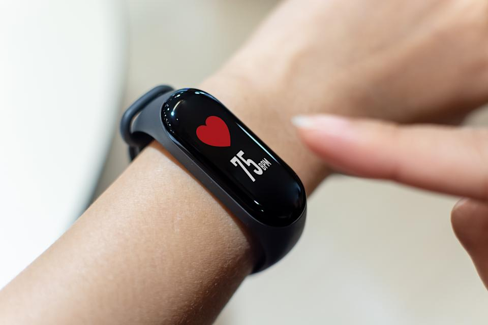 Close up image hand of male using smart watch with health app checking measure heart rate at normal levels