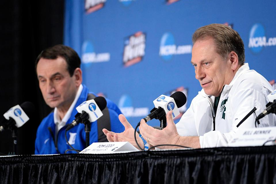 Michigan State basketball coach Tom Izzo, right, speaks to the media as Duke coach Mike Krzyzewski listens Thursday, April 2, 2015, at Lucas Oil Stadium.