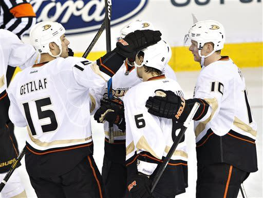 Anaheim Ducks' Ryan Getzlaf (15), Ben Lovejoy, center, and Corey Perry (10) celebrate a goal on the Edmonton Oilers during the third period of their NHL hockey game in Edmonton, Alberta, Sunday, April 21, 2013. The Ducks won 3-1. (AP Photo/The Canadian Press, Jason Franson)
