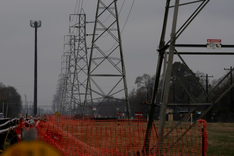 FILE PHOTO: Overhead power lines are seen during record-breaking temperatures in Houston, Texas
