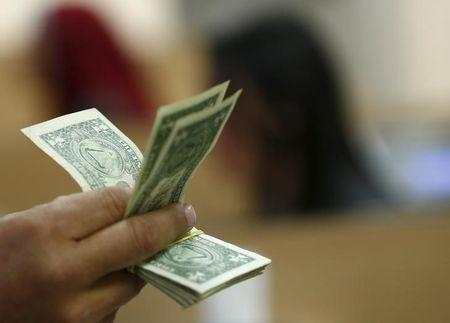 Dollar firm near 5-month highs, euro below $1.18