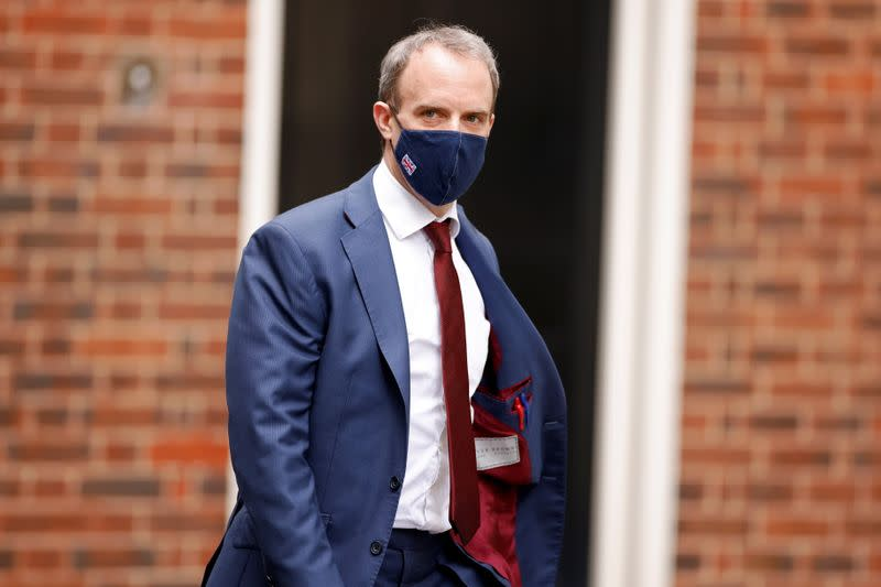 Britain's Foreign Affairs Secretary Dominic Raab walks outside Downing Street in London
