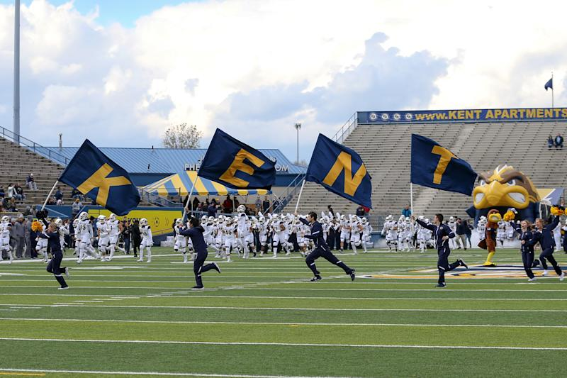 KENT, OH - OCTOBER 20: The Kent State Golden Flashes cheerleaders lead the Golden Flashes on to the field prior to the college football rivalry game between the Akron Zips and Kent State Golden Flashes on October 20, 2018, at Dix Stadium in Kent, OH. Akron Defeated Kent State 24-23 in overtime. (Photo by Frank Jansky/Icon Sportswire via Getty Images)
