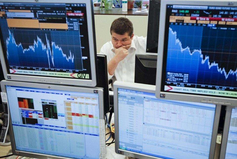 A trader monitors bond prices on trading terminals. Photo: EPA-EFE
