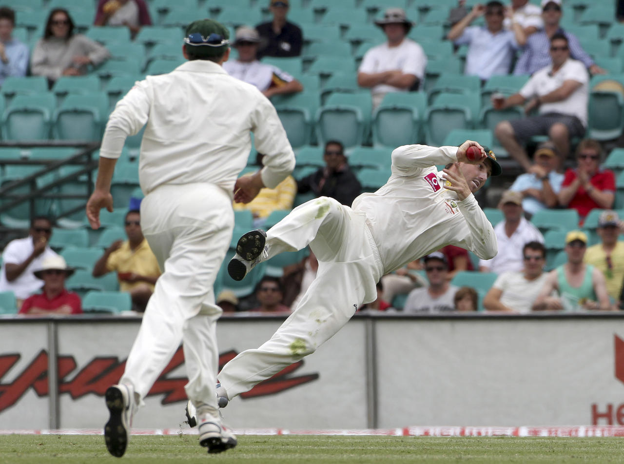 Australia's Shaun Marsh flies high as he catches out India batsman Zaheer Khan on day 4 of the second test match at the Sydney Cricket Ground in Sydney, Australia, Friday, Jan. 6, 2012. (AP Photo/Rob Griffith)