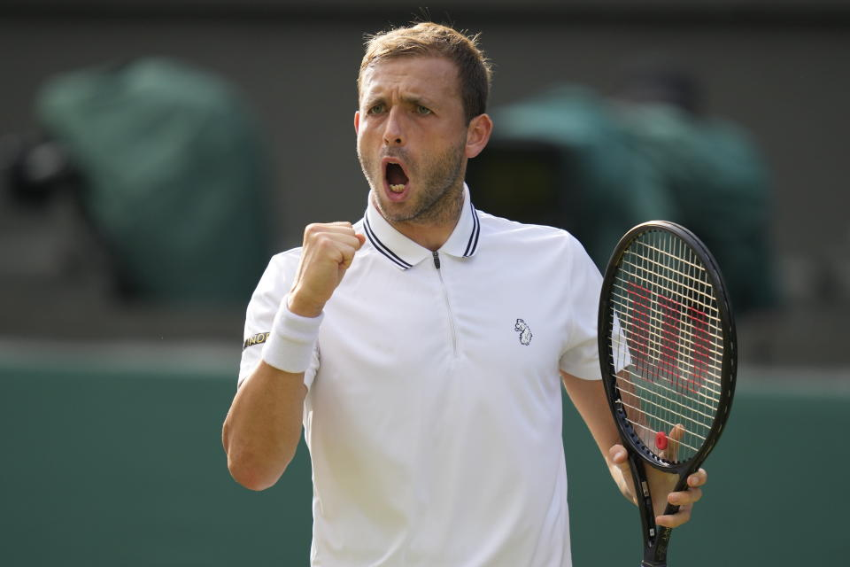 Britain's Daniel Evans celebrates winning a point against Sebastian Korda of the US during the men's singles third round match on day five of the Wimbledon Tennis Championships in London, Friday July 2, 2021. (AP Photo/Kirsty Wigglesworth)