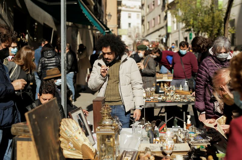 People shop at El Rastro flea market in Madrid