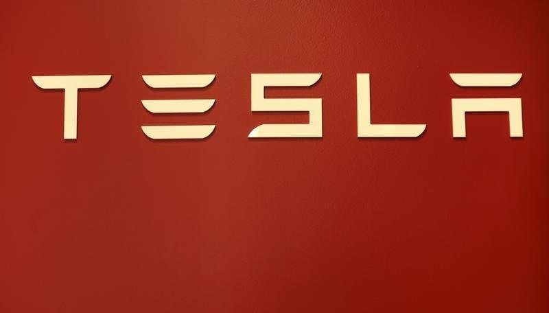 A Tesla Motors logo is shown at a Tesla Motors dealership at Corte Madera Village, an outdoor retail mall, in Corte Madera