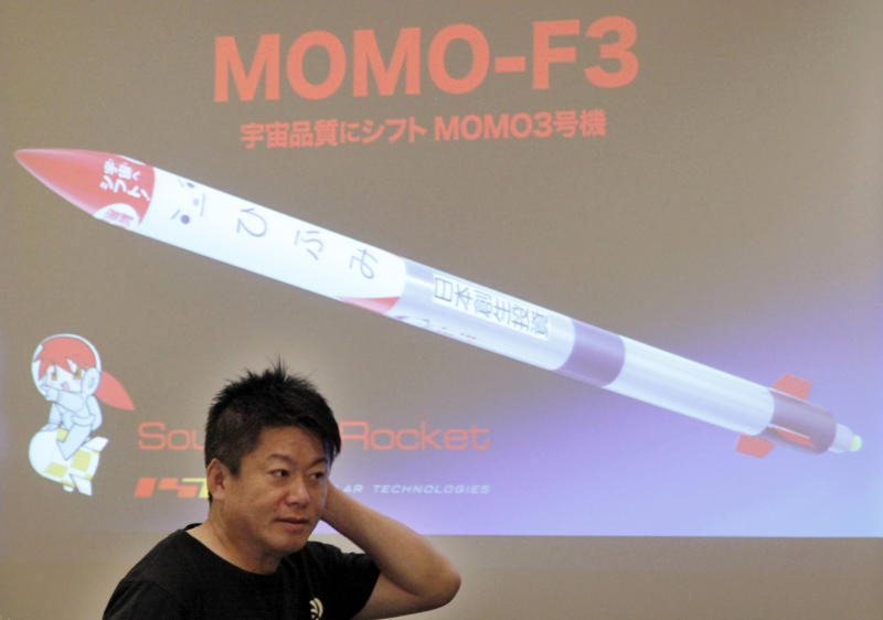 Japanese entrepreneurs and Founder of Interstellar Technologies Inc. Takafumi Horie speaks during a press conference in Tokyo, Wednesday, May 15, 2019. Horie said a low-cost rocket business in Japan is well-positioned to accommodate scientific and commercial needs in Asia. While Japan's government-led space programs have demonstrated top-level technology, he said the country has fallen behind commercially due to high costs. (AP Photo/Koji Sasahara)