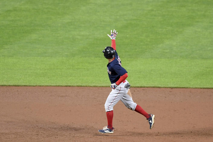Boston Red Sox's Xander Bogaerts celebrates as he rounds the bases after hitting a two-run home run against the Baltimore Orioles in the sixth inning of a baseball game, Saturday, May 8, 2021, in Baltimore. (AP Photo/Will Newton)