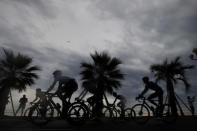 The pack rides along the beach of the Promenade des Anglais during the first stage of the Tour de France cycling race over 156 kilometers (97 miles) with start and finish in Nice, southern France, Saturday, Aug. 29, 2020. (AP Photo/Christophe Ena)