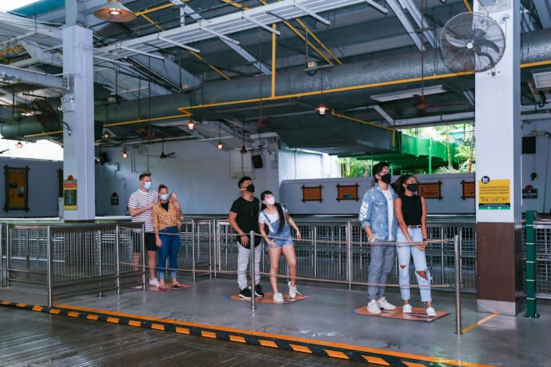 A posed photo of Universal Studios Singapore guests queueing for a ride with safe distancing of one-metre spacings. Resorts World Singapore attractions on Sentosa, including Universal Studios Singapore and the S.E.A. Aquarium, will reopen in Phase 2 of Singapore's reopening during the COVID-19 pandemic. (Photo: RWS)