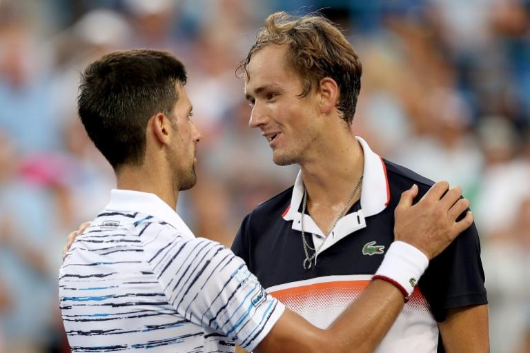 World number one Novak Djokovic of Serbia congratulates Daniil Medvedev after falling to the Russian in the semi-finals of the ATP Cincinnati Masters