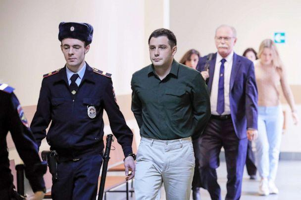 PHOTO: U.S. ex-Marine Trevor Reed, who was detained in 2019 and accused of assaulting police officers, is escorted before a court hearing in Moscow, March 11, 2020.  (Tatyana Makeyeva/Reuters, FILE)