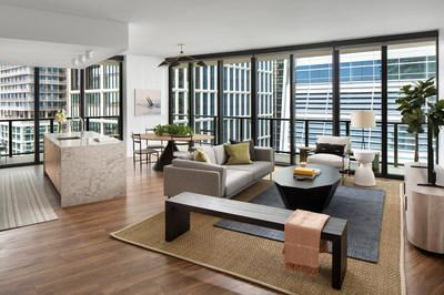 This photo shows the living room in a two-bedroom model unit in Heron, a new residential rental building that welcomed the first residents to the highly anticipated Water Street Tampa neighborhood.