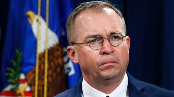 PHOTO: Mick Mulvaney, acting director of the Consumer Financial Protection Bureau (CFPB), and Director of the Office of Management, listens during a news conference at the Department of Justice in Washington, July 11, 2018. (Jacquelyn Martin/AP, FILE)
