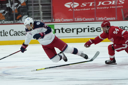 Detroit Red Wings right wing Bobby Ryan (54) trips Columbus Blue Jackets defenseman Michael Del Zotto (15) in the third period of an NHL hockey game Monday, Jan. 18, 2021, in Detroit. (AP Photo/Paul Sancya)