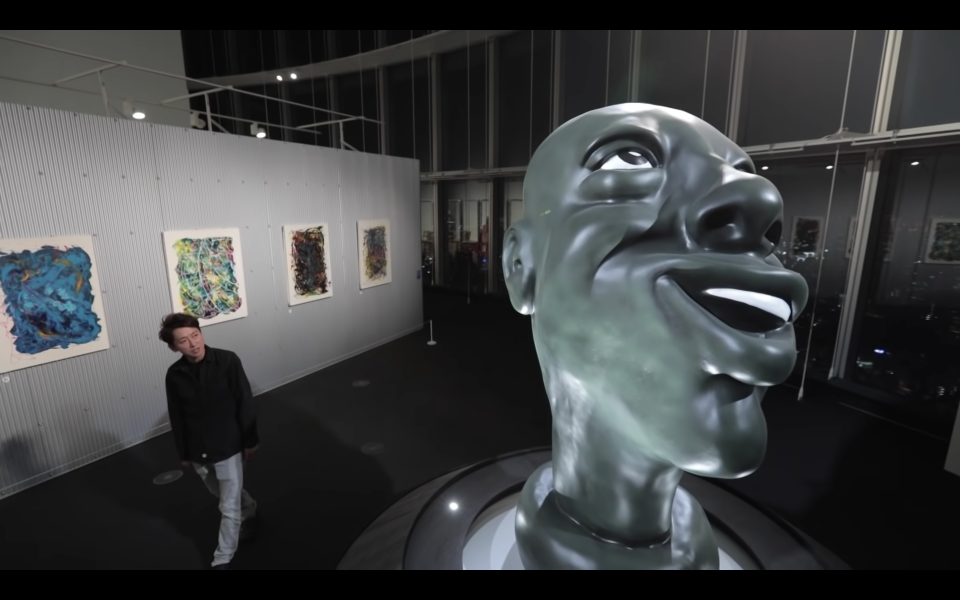 An enlarged figure of a smiling face from Arashi singer Satoshi Ohno's first art exhibition.