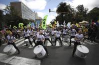 A music group plays drums during an anti-government march in Bogota, Colombia, Wednesday, May 12, 2021. (AP Photo/Fernando Vergara)