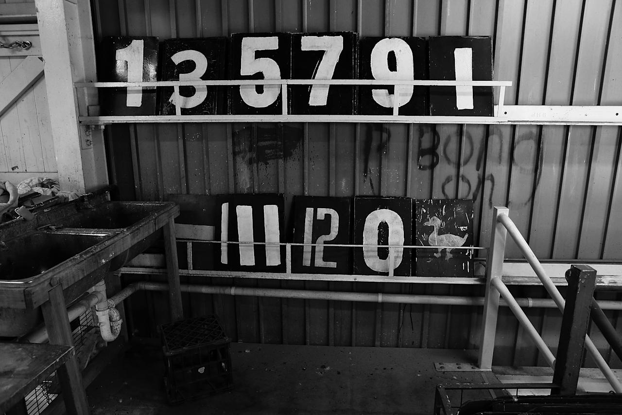 CANBERRA, AUSTRALIA - DECEMBER 08:  (EDITORS NOTE: Image has been converted to Black & White) Numerical boards are stacked inside The Jack Fingleton Scoreboard during an international tour match between the Chairman's XI and Sri Lanka at Manuka Oval on December 8, 2012 in Canberra, Australia. The Jack Fingleton Scoreboard was first erected at the MCG in 1901. In 1982 it was replaced by an electronic board and donated to the Manuka Oval by the Melbourne Cricket Club as memorial to J.H.W Fingleton OBE.  (Photo by Brendon Thorne/Getty Images)